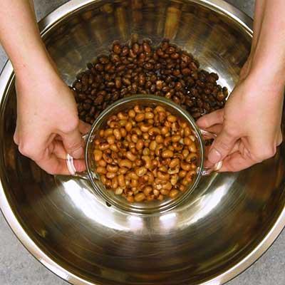 Cowboy Caviar Step 2 - Add black eyed peas.