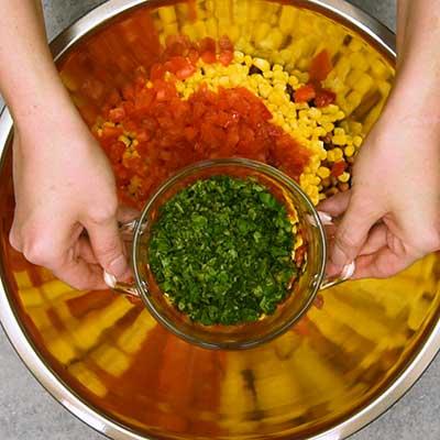 Cowboy Caviar Step 2 - Add cilantro.