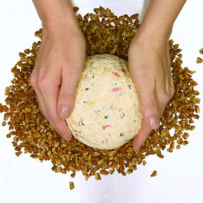 Pineapple Cheese Ball Step 5 - Place chilled cheese ball on pecans.