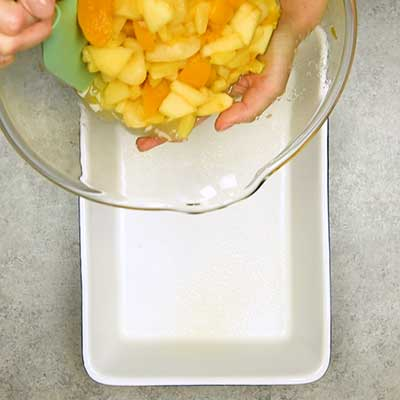 Spiced Fruit Bake Step 2 - Pour fruit into casserole dish.