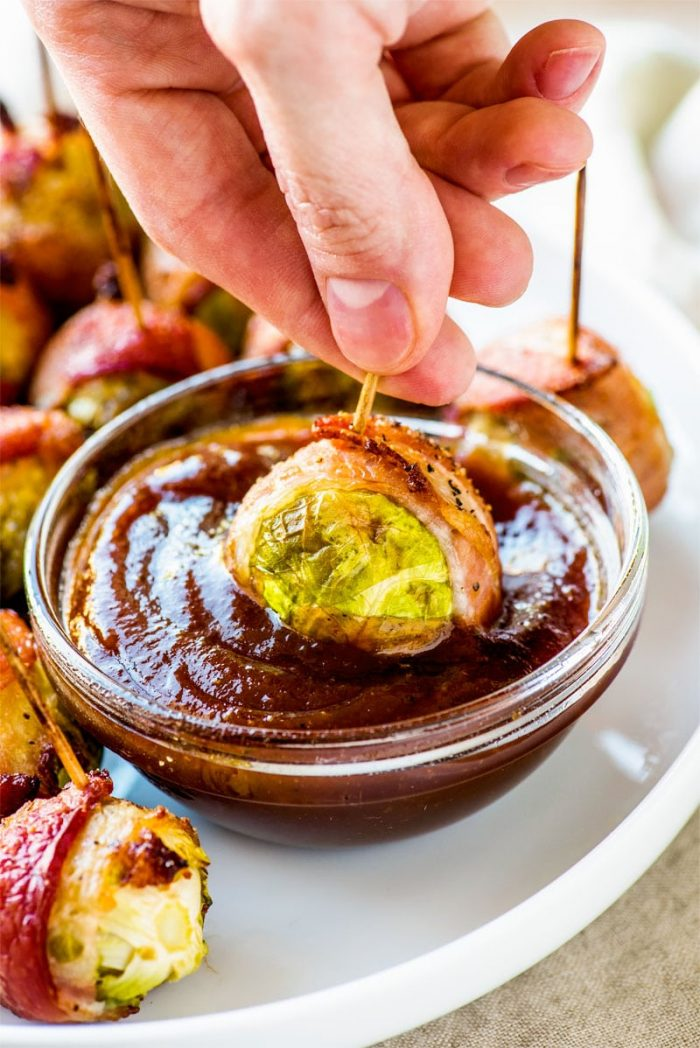 Bacon Wrapped Brussels Sprouts! When it comes to creative appetizers, these bacon wrapped Brussels sprouts with maple syrup are sure to steal the show. Get the instant appeal of bacon, the savory greens of the sprout, and a dash of maple syrup all in one easy finger food.   HomemadeHooplah.com