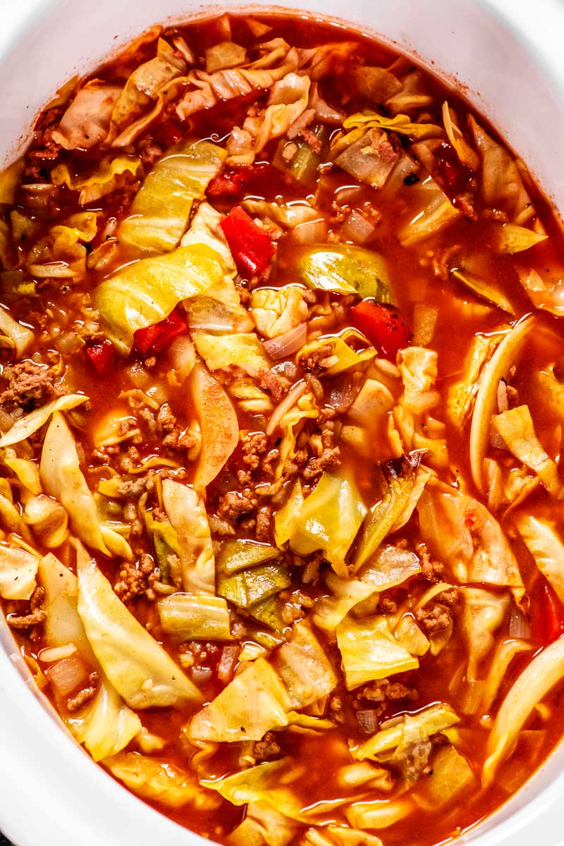 Crock Pot Cabbage Roll Soup! This easy crock pot cabbage roll soup gives you all the flavor of a cabbage roll but for a fraction of the work. Just fill the pot, let it simmer, then eat! | HomemadeHooplah.com