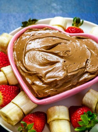 Chocolate Fruit Dip! Satisfy your sweet tooth with this chocolate fruit dip that can be made in just 10 minutes. Great as an appetizer or dessert and served with cookies or fruit. | HomemadeHooplah.com