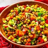 Cowboy Caviar! Loaded with fresh veggies and topped with a tasty vinaigrette, this colorful cowboy caviar (also called Texas caviar) is the summer salsa that packs some heat! | HomemadeHooplah.com