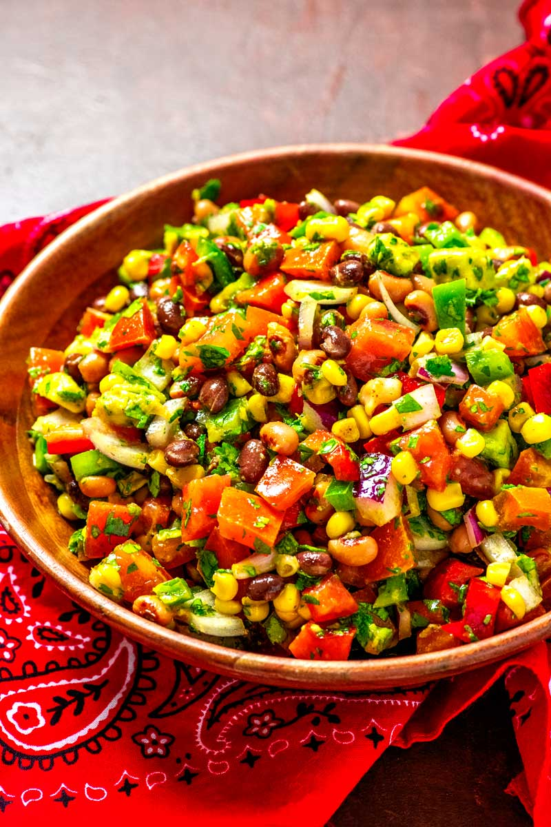 Cowboy Caviar! Loaded with fresh veggies and topped with a tasty vinaigrette, this colorful cowboy caviar (also called Texas caviar) is the summer salsa that packs some heat!   HomemadeHooplah.com
