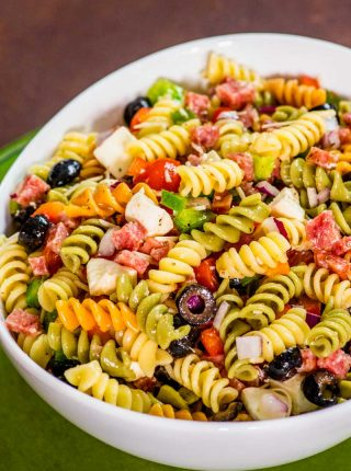 Italian Pasta Salad! This easy cold Italian pasta salad packs a ton of flavor with Italian salami and freshly chopped veggies that are tossed with rotini pasta and Italian dressing. | HomemadeHooplah.com