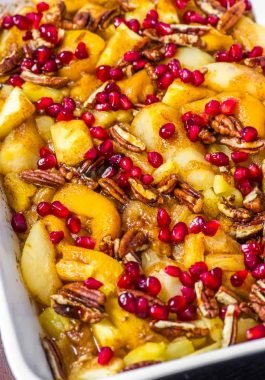 Spiced Fruit Bake! This spiced fruit bake is a fast and easy breakfast casserole made with apples, pineapple, pears, peaches, pecans, pomegranate seeds, and a touch of cinnamon. | HomemadeHooplah.com