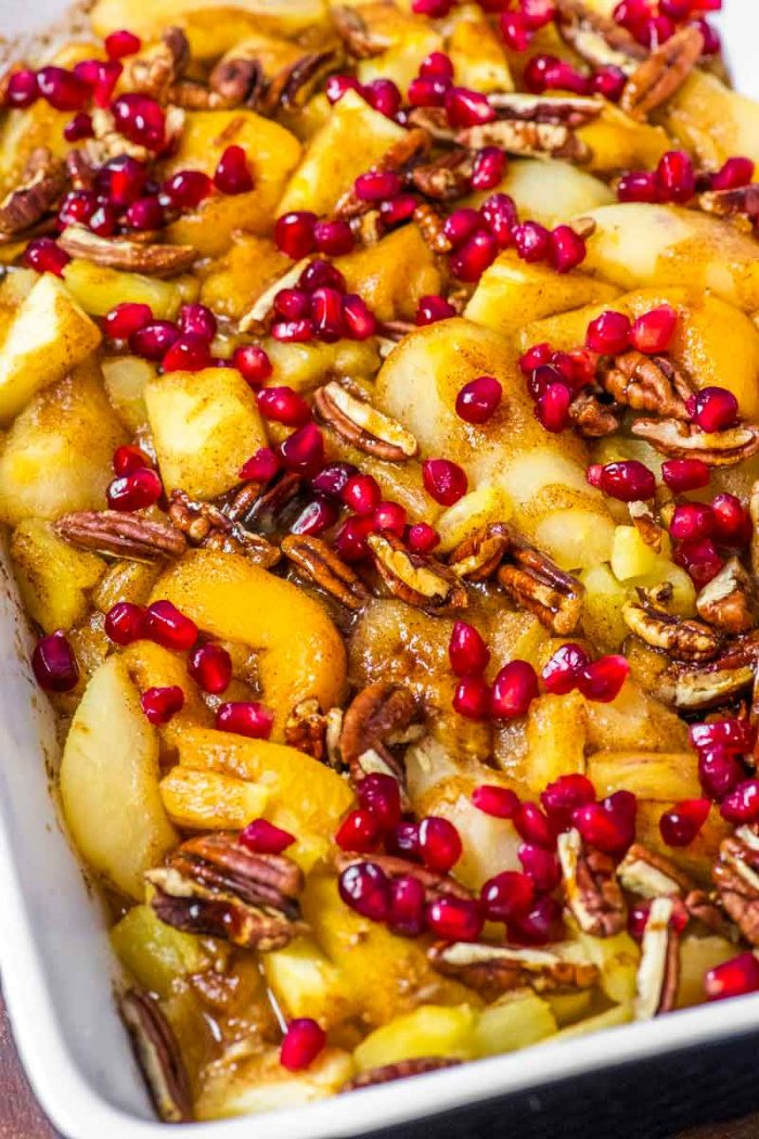 Spiced Fruit Bake! This spiced fruit bake is a fast and easy breakfast casserole made with apples, pineapple, pears, peaches, pecans, pomegranate seeds, and a touch of cinnamon.   HomemadeHooplah.com