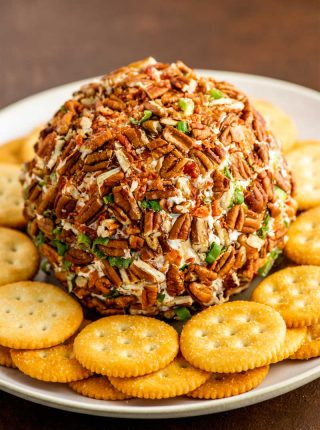 Bacon Ranch Cheese Ball! With a creamy mix of crumbled bacon, crunchy pecans, cheddar cheese, and tasty ranch seasoning, this retro bacon ranch cheese ball is ready for your next party! | HomemadeHooplah.com