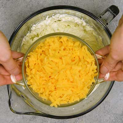 Bacon Ranch Cheese Ball Step 3 - Add cheddar cheese.
