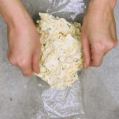 Bacon Ranch Cheese Ball Step 4 - Wrap cheese ball mixture in the plastic wrap.