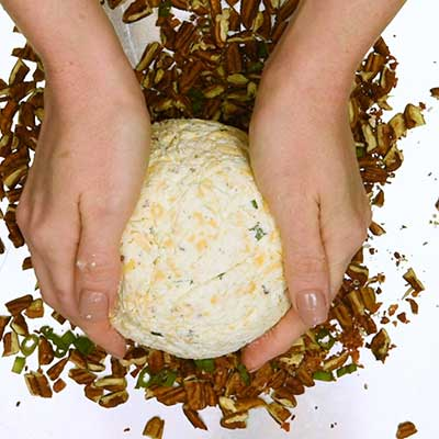 Bacon Ranch Cheese Ball Step 6 - Place cheese ball on pecan mixture.