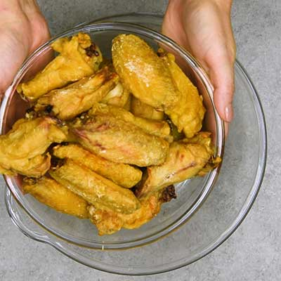 Teriyaki Chicken Wings Step 8 - Add baked chicken wings to a bowl.