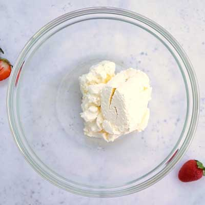 Strawberry Stuffed Cream Cheese Step 1 - Add cream cheese.
