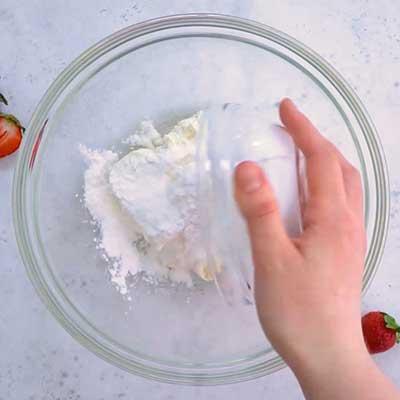 Strawberry Stuffed Cream Cheese Step 1 - Add powdered sugar.