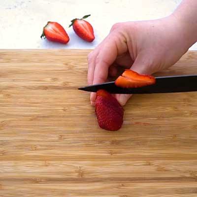 Strawberry Stuffed Cream Cheese Step 2 - Slice strawberries.