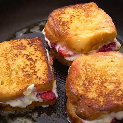 Strawberry Stuffed Cream Cheese Step 5 - Fry stuffed french toast until golden brown.