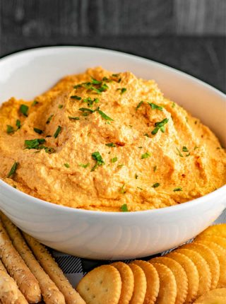 Pimento Cheese Spread! This zesty and flavorful homemade pimento cheese spread is a quick and easy addition to any appetizer, lunch, or dinner. Serve as a fun dip or a creamy spread. | HomeamdeHooplah.com