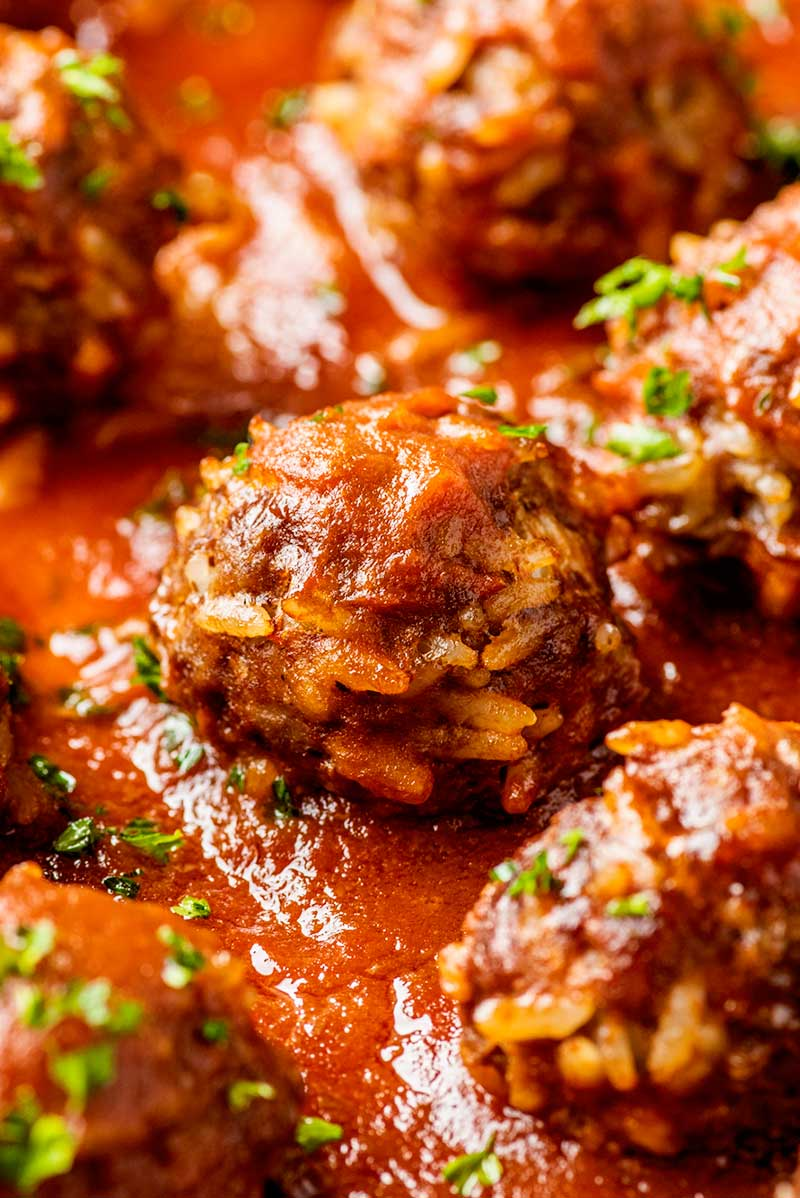 Meatballs baked with rice and coated with pasta sauce.