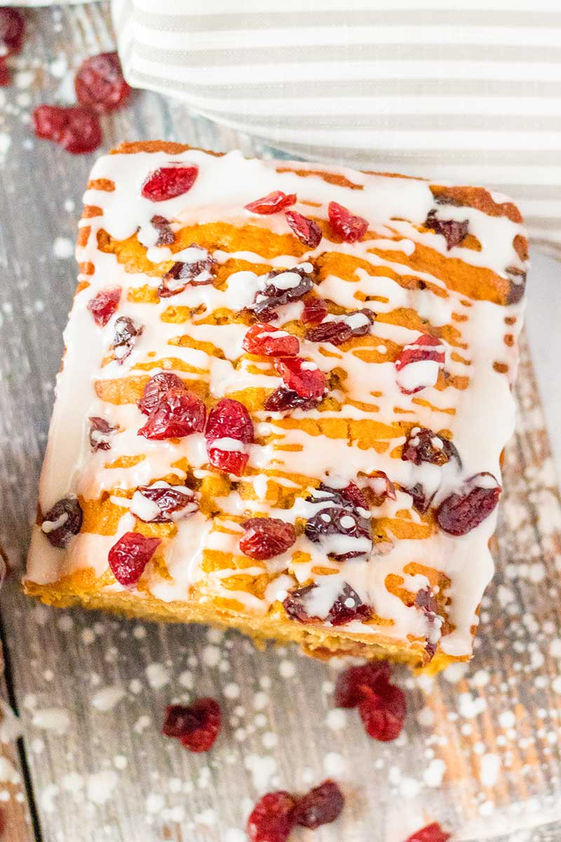 Sweet potato bread drizzled with frosting and dried cranberries