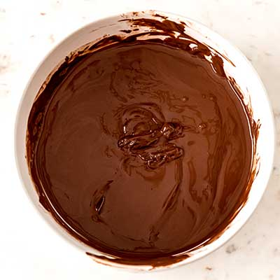 Step 2 - Melt and stir chocolate and coconut oil together.