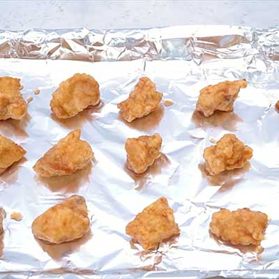 Baked Sweet and Sour Chicken Step 4 - Arrange coated chicken on a baking sheet.