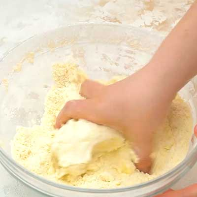 Glazed Fruit Pizza Step 1 - Use your hands to knead dough.