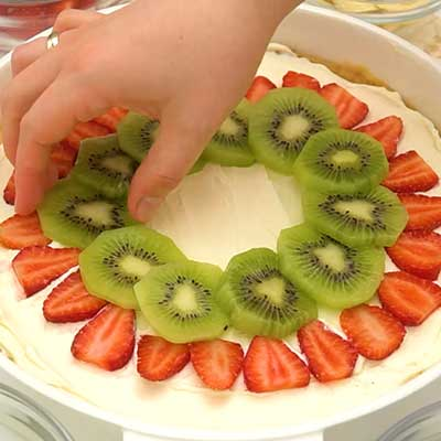 Glazed Fruit Pizza Step 6 - Decorate with fruit on top of frosting.