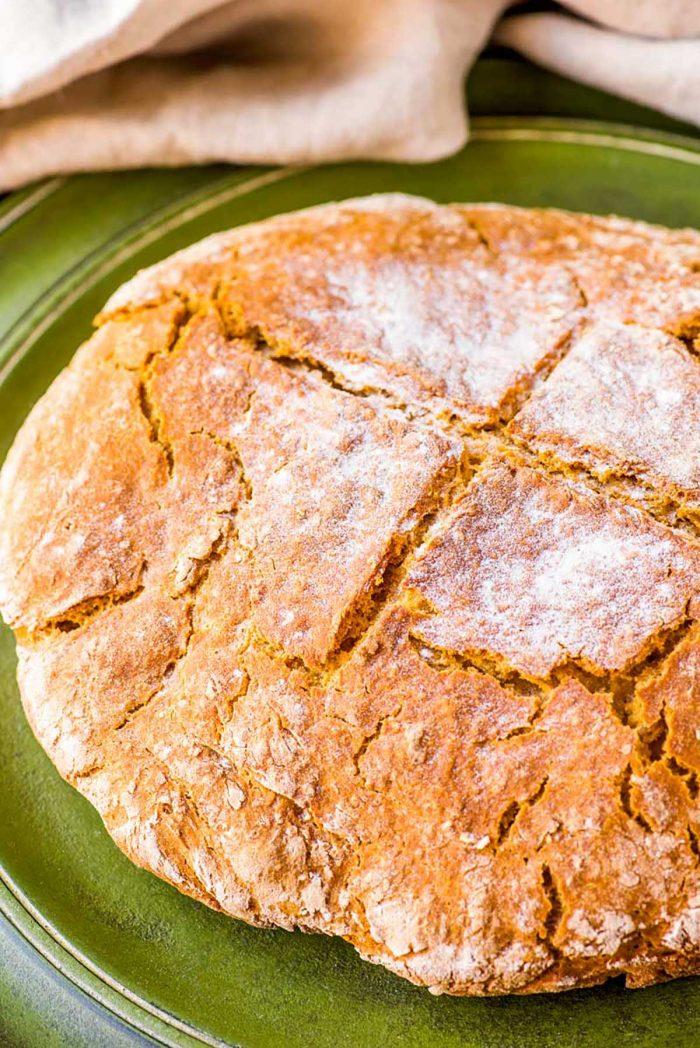Easy Irish soda bread baked and scored on top.