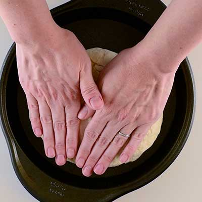 Traditional Irish Soda Bread Step 4 - Gently press dough to the edges of the pan.