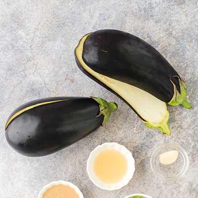 Baba Ganoush Step 1 - Cut eggplants.