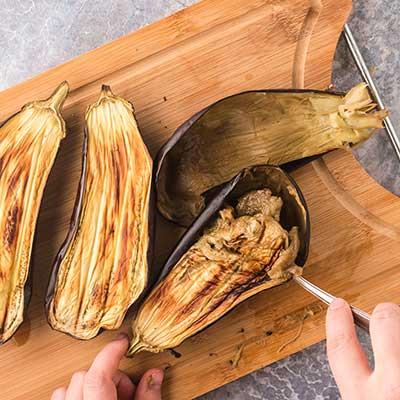 Baba Ganoush Step 3 - Scoop flesh out of eggplants.