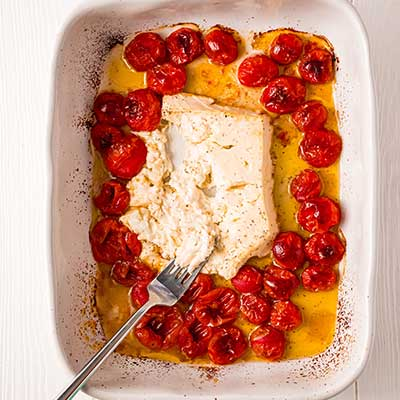 Baked Feta Pasta Step 4 - Use a fork to break apart tomatoes and feta.