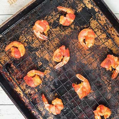 Cajun Bacon Wrapped Shrimp Step 8 - Arrange baked shrimp on baking rack.