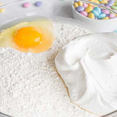 Cool Whip Cookies Step 1 - Add cake mix, cool whip, and egg to bowl.