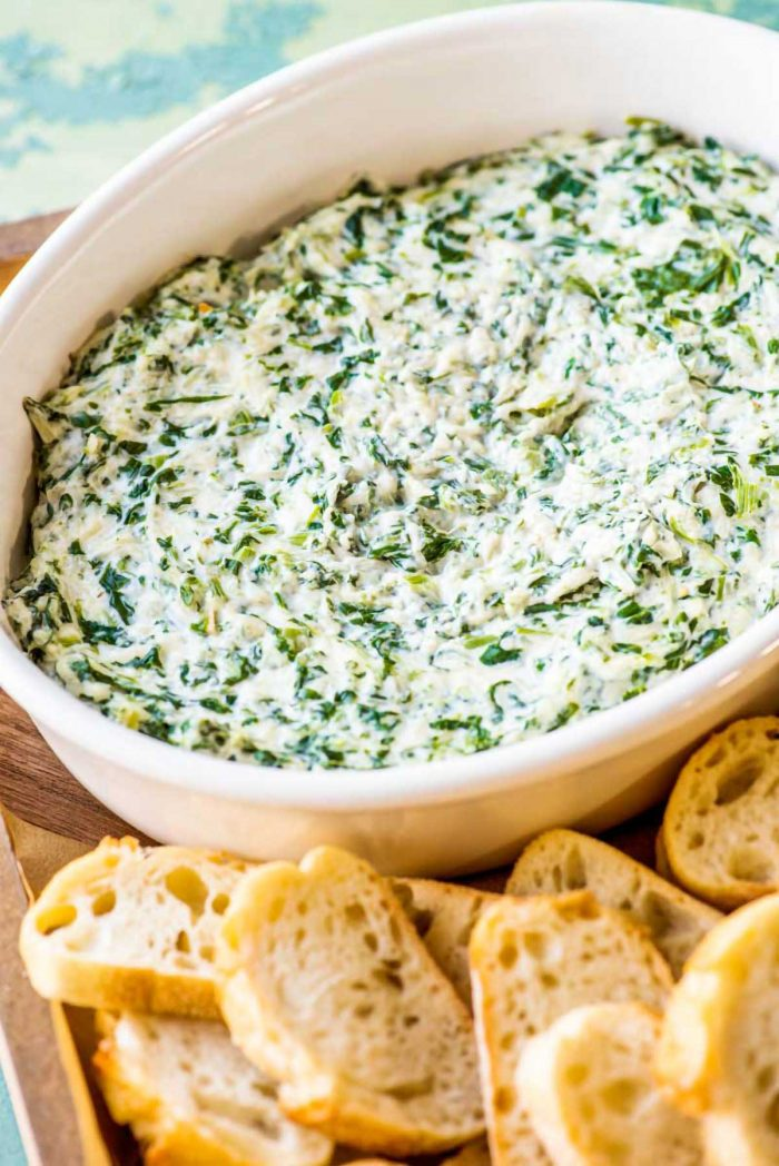 Easy hot, creamy spinach dip served with french bread.