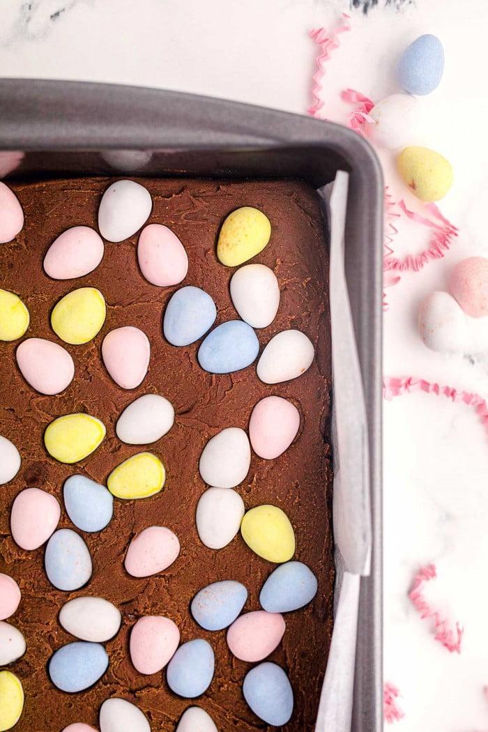 Classic chocolate fudge in a pan with Cadbury Mini Eggs.