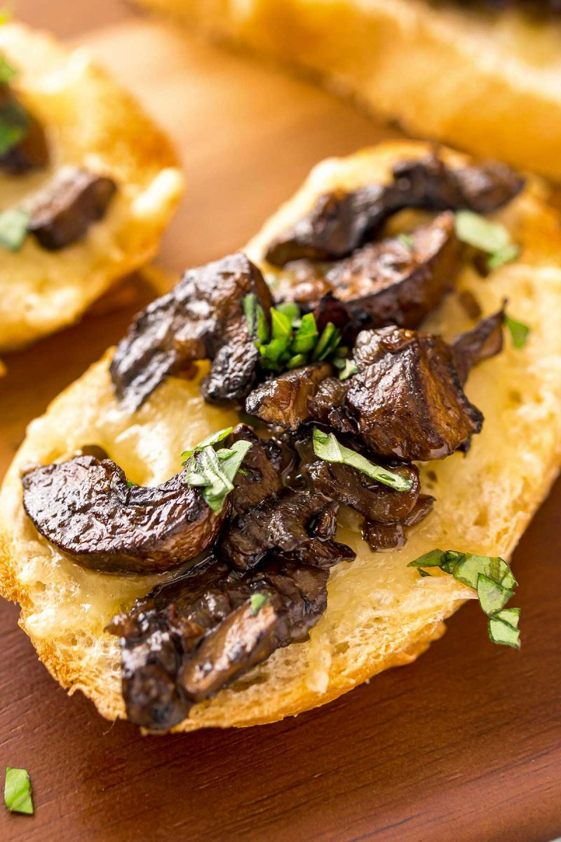 Tender cooked mushrooms on toast for an appetizer or brunch