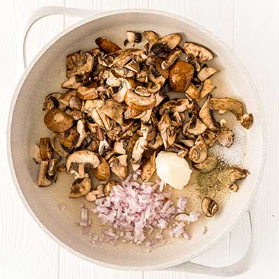 Mushrooms on Toast Step 1 - Add butter, mushrooms, and shallot to a hot skillet.