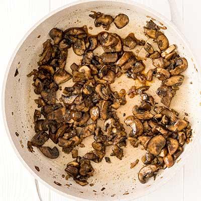 Mushrooms on Toast Step 1 - Cook mushrooms until slightly browned and tender.