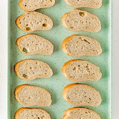 Mushrooms on Toast Step 4 - Toast 12 slices of bread.