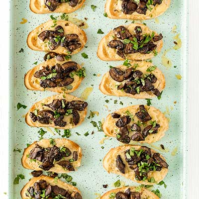 Mushrooms on Toast Step 4 - Broil mushroom toasts again then top with fresh chopped basil.