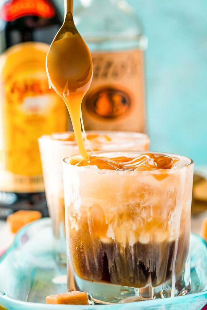 Drizzling caramel over a White Russian cocktail.