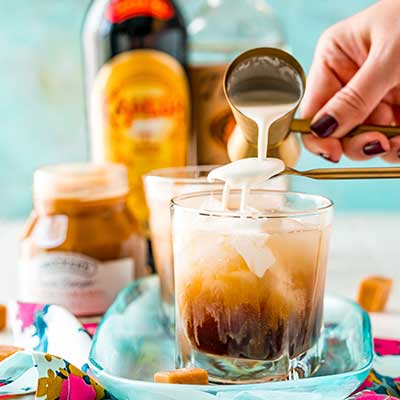 Salted Caramel White Russian Step 3 - Pour heavy cream over a spoon.