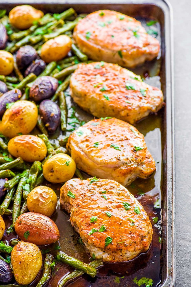 Tender ranch pork chops and vegetables in a sheet pan.