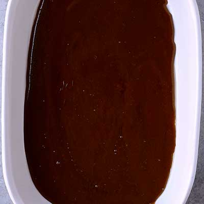 Creme Brulee French Toast Step 4 - Pour caramel sauce until it completely cover the bottom of a baking dish.