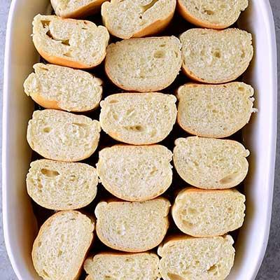 Creme Brulee French Toast Step 5 - Arrange sliced bread on top of caramel layer.