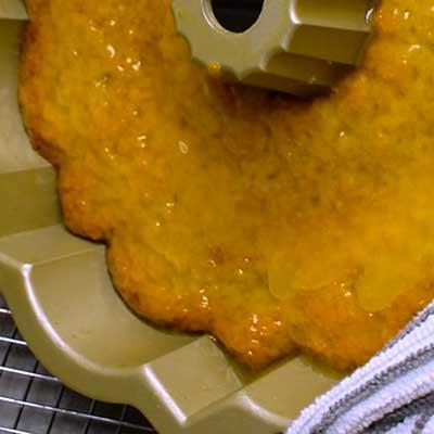 Kentucky Butter Cake Step 7 - Lift and tilt pan to coat with glaze.