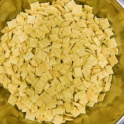 Puppy Chow Step 3 - Add Chex cereal to a large bowl.