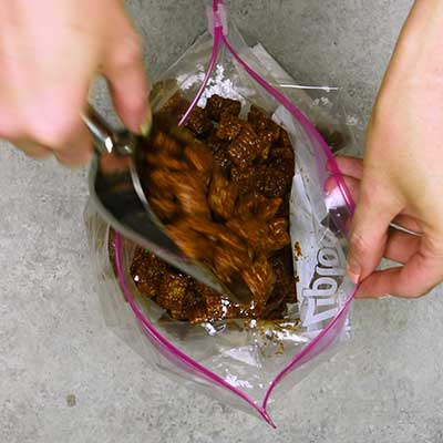 Puppy Chow Step 4 - Add coated Chex cereal to bag.